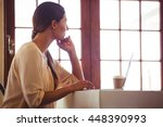 woman using a laptop in a... | Shutterstock . vector #448390993