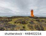 Orange Lighthouse At The Coast...