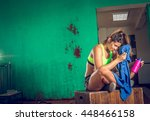 exhausted gym girl drinking... | Shutterstock . vector #448466158