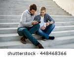 two guys sitting on stairs with ... | Shutterstock . vector #448468366