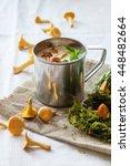 chanterelle cream soup in iron... | Shutterstock . vector #448482664