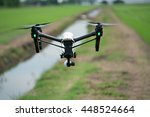 drone is flying above the rice... | Shutterstock . vector #448524664