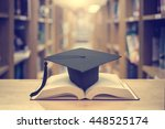graduation cap over open books... | Shutterstock . vector #448525174