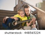father learning his boy to play ...   Shutterstock . vector #448565224