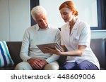 Nurse And Senior Man Using A...