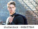 handsome young man walking in... | Shutterstock . vector #448657864