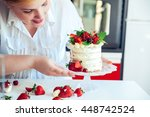 woman carefully icing the cake...   Shutterstock . vector #448742524