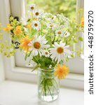 Small photo of jam jar flowers - yellow and white wildflowers with alchemilla mollis in jam jar on kitchen windowsill
