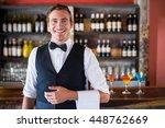 portrait of confident waiter... | Shutterstock . vector #448762669