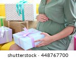 Pregnant Woman With Presents A...