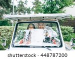 bride and groom driving a golf... | Shutterstock . vector #448787200