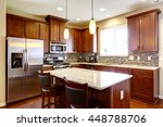 Stock photo kitchen mahogany storage combination with steel kitchen appliances pendant lights and back splash 448788706