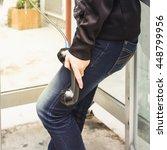 man holding a public phone | Shutterstock . vector #448799956