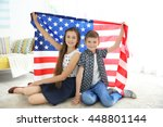 kids and american flag in room | Shutterstock . vector #448801144