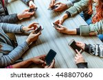 People Using Smart Phones With...