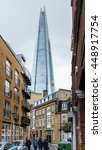 Small photo of LONDON, UNITED KINGDOM - FEBRUARY 20, 2015: people walking by downtown Southwark district street with buildings of classic architecture in contrast to The Shard skyscraper's futuristic glass façade.