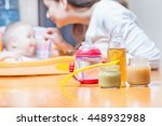 mom feeds the baby pure.... | Shutterstock . vector #448932988