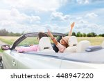 happy couple driving in... | Shutterstock . vector #448947220