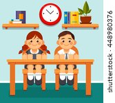 Two Pupil In Classroom Sitting...