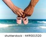 Couple Holding Baby's Shoe On...