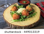 fried risotto balls sitting on... | Shutterstock . vector #449013319