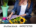 Female Florist Wrapping Flower...
