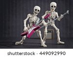 Two Skeletons Band Playing Roc...