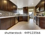 Stock photo modern kitchen interior with dark brown storage cabinets with granite counter tops and new tile 449123566