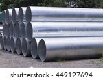 Stacked Aluminum Metal Pipes.