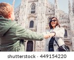 Small photo of Mother wit son take for hands on the square near Duomo di Milano