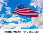 american flag on blue sky | Shutterstock . vector #449159230
