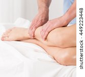 Small photo of Physical therapist doing lymphatic drainage for the legs