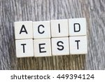 "Small photo of ""ACID TEST"" printed on dice over head view on wood background"