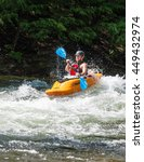 Small photo of Minden, Ontario - July 5, 2016: White water kayak paddler steering his boat through the rough rapids on Gull River at the Minden Whitewater Preserve