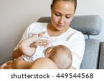 Caring Young Mother Breastfeed...