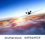 private jet plane flying above... | Shutterstock . vector #449564929