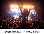 girl on shoulders in the crowd... | Shutterstock . vector #449575540