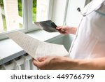 doctor checking x ray results | Shutterstock . vector #449766799