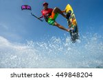 a kite surfer rides the waves | Shutterstock . vector #449848204