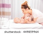 mother and her baby on changing ... | Shutterstock . vector #449859964