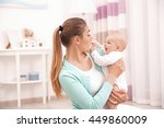 mother and her little baby at... | Shutterstock . vector #449860009
