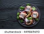 Stock photo canape with herring fillet black wooden surface above view 449869693