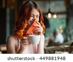 red haired girl in a cafe  ... | Shutterstock . vector #449881948