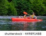 family on kayaks and canoe tour....   Shutterstock . vector #449891488