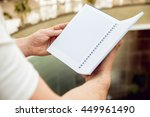 a man holding a notebook in his ... | Shutterstock . vector #449961490