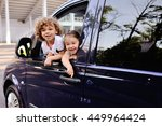children look out from a car... | Shutterstock . vector #449964424