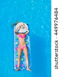 Small photo of Relaxing in a swimming pool on an air mattress
