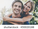 happy loving couple. low angle... | Shutterstock . vector #450020188