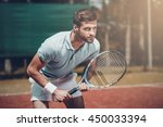 full concentration. handsome... | Shutterstock . vector #450033394