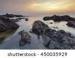 sea waves lash line impact rock ... | Shutterstock . vector #450035929
